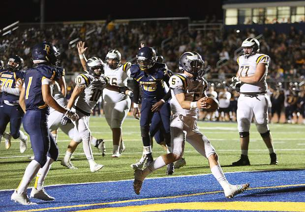Nevada Union running back Dawson Fay (5) slips into the end zone uncontested for one of his five touchdowns of the evening during the Miners' 53-21 win over the River City Raiders.