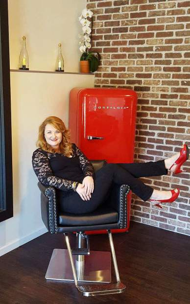 Dawnelle Casey sits in her salon The Hair Lounge, off of Railroad Avenue in Nevada City, which features a vintage remodel.