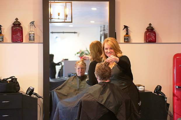 Dawnelle Casey smiles as she works on her clients last week doing what she's envisioned herself doing since she was a child. Casey now runs her own salon, The Hair Lounge, off of Railroad Avenue in Nevada City.