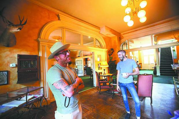 Holbrooke Hotel owner Jordan Fife (left) stands with Michael Worth inside of the historic downtown Grass Valley hotel which re-opened this week. The two will continue on planned renovations in the coming months.