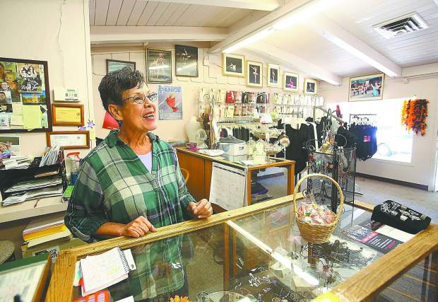Delores Jones smiles from her Pioneer Plaza establishment where she's been selling dancing shoes and other accessories for decades.