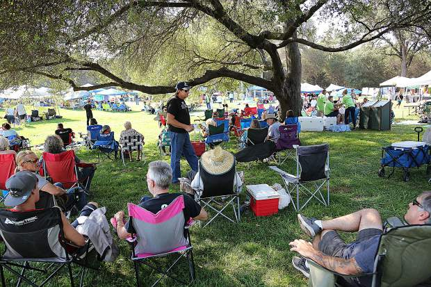 Praise In the Mountains attendees find shady spots to listen to the 6 Christian bands sharing the gospel through music and speaking Saturday at Western Gateway Park.
