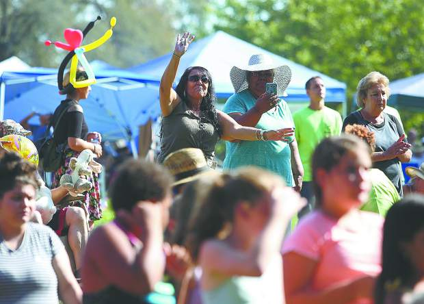 Yuba City's Gloria Chavez praises the Lord as she dances along to the music from Saturday's annual Praise In The Mountains evangelical event at Western Gateway Park in Penn Valley.