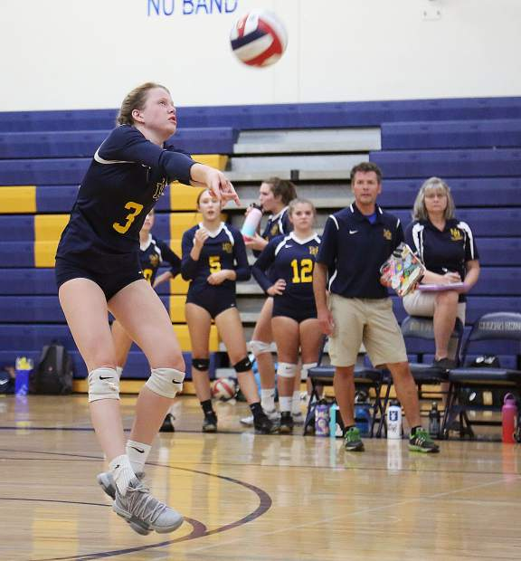 Nevada Union junior Faith Menary (3) bumps the ball while receiving a serve from the Pleasant Valley Vikings Wednesday at Albert Ali Gymnasium.