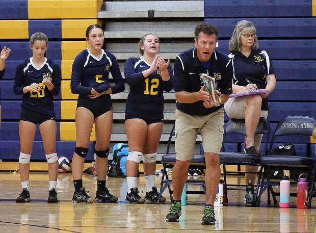 Nevada Union head coach Chrys Dudek applauds his teams effort during a five-set victory over Pleasant Valley Wednesday night.