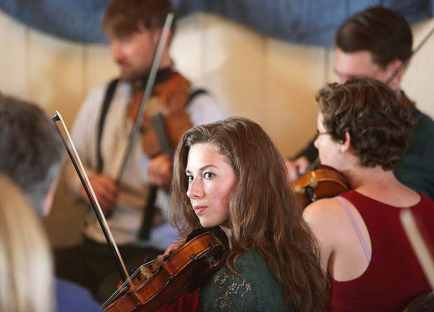 Reno's Brigit McNeil plays the fiddle alongside other youth playing in the Galen Fraser and co-hosts youth session on the Salem Street Session Stage. Participants at the festival with instruments, and familiar with the tunes can join in on the sessions.