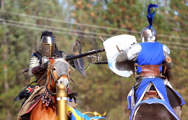 The lances of black knight Sir Thomas, and blue knight Sir Geoffrey splinter as they meet in fully armored combat during the annual KVMR Celtic Festival held at the Nevada County Fairgrounds over the weekend.