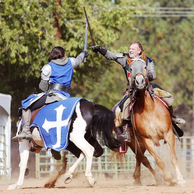 The black knight Sir Thomas, and blue knight Sir Geoffrey draw their swords on one another during the annual KVMR Celtic Festival held at the Nevada County Fairgrounds over the weekend.