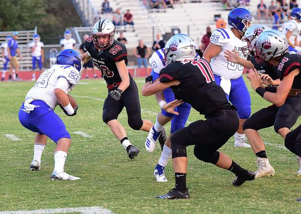 Bear River's Jared Baze (58) closes in on an El Dorado ball carrier during a game Friday night.