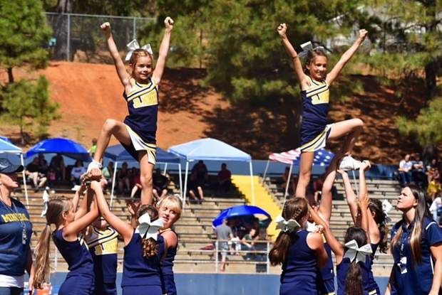 Nevada Union Jr. Miners10U cheerleaders perform during Saturday's Homecoming Game against Placer.