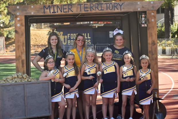 Nevada Union Jr. Miners 8U cheerleaders pose for a team photo during Saturday's Homecoming Game against Placer.