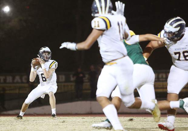 Nevada Union senior Parker Heilaman (6) looks for an open receiver during Friday's matchup against the Placer Hillmen. The passing game for Nevada Union was shut down by Placer as Heilaman was good for 3 yards off of two passes.