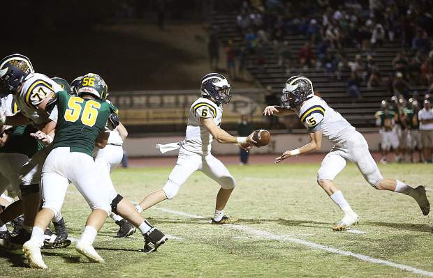 Nevada Union quarterback Parker Heilaman (6) hands the ball off to running back Dawson Fay (6) who was good for 179 yards and two touchdowns.