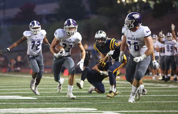 Spanish Springs running back Parker Luthy (23) breaks away from the Nevada Union defense before scoring a touchdown.