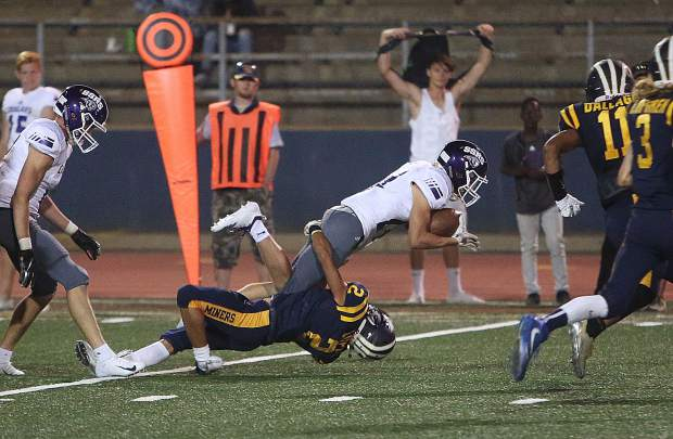 Nevada Union's Dereck Lopez pulls down a Spanish Springs ball carrier during Friday's home opener against the Cougars.