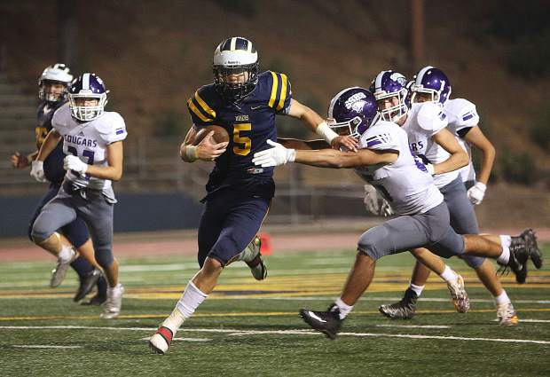 Nevada Union running back Dawson Fay (5) rushed for a team-high 133 yards and two touchdowns during a game against the Spanish Springs Cougars Friday night at Hooper Stadium.