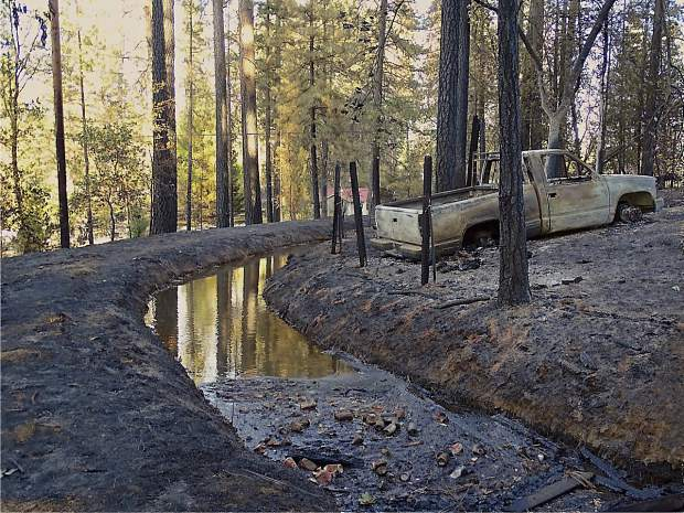 Remnants of a car and property damaged by the McCourtney Fire last week on McCourtney Road.