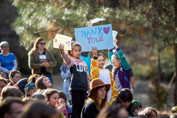 Nevada City School of the Arts students hold signs thanking first responders to the Lobo Fire during a gathering at the school.