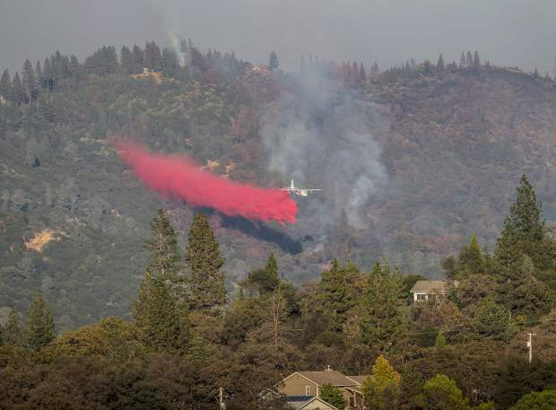 An air tanker dropping fire retardant on the Lobo Fire.