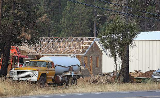 A home that burned in last year's McCourtney Fire is being rebuilt adjacent to the property where a PG&E base camp is being set up across from the Nevada County Fairgrounds.