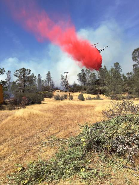 Air drop on a McCourtney Road fire near Van Tam Road.