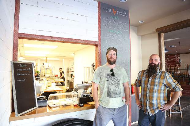 Sean Cox and Nathan Keys stand in front of the Roost pub grub window inside of Grass Valley Brewing Company's taproom. Both Roost and the taproom are now open for business.