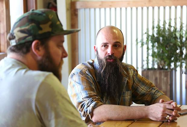 Nathan Keys (right) talks with Roost partner Sean Cox talk about the trials and tribulations involved with the years long process of opening the pub grub eatery.