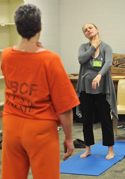 Nevada County local yoga and Ayurveda instructor Schuyler Bright, leads a group of women inmates through a yoga session at the Women's Behavioral Correctional Facility in Nevada County last week.