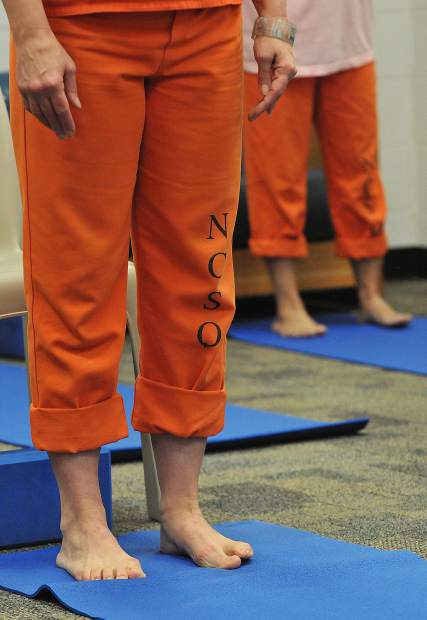 Inmates take part in the Mindfulness program's yoga session at the Wayne Brown Correctional Facility.