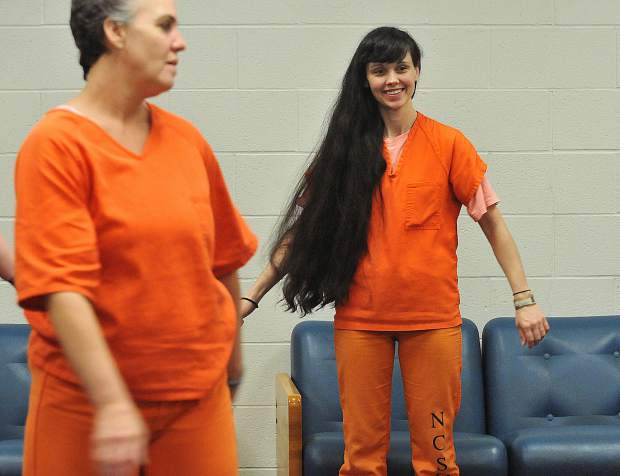 Nevada County inmates smile as they get to participate in the correctional facilities' yoga program.