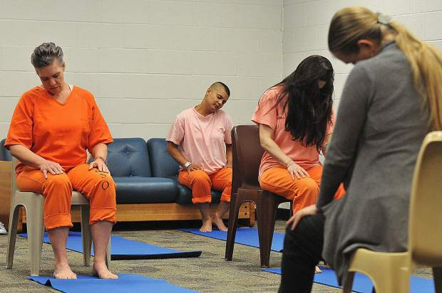 Jail yoga participants begin their session last Friday, led by Nevada County yoga and Ayurveda instructor Schuyler Bright.