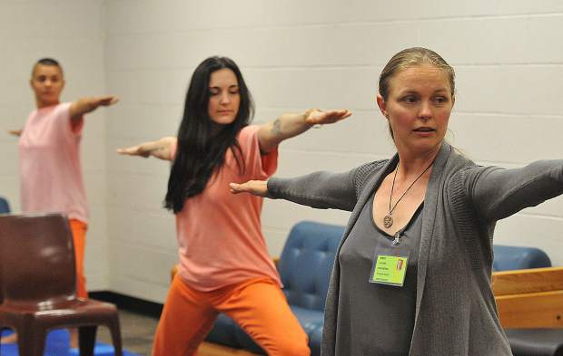 Nevada County local yoga and Ayurveda instructor Schuyler Bright leads a group of women inmates through a yoga session at the Women's Behavioral Correctional Facility in Nevada City.