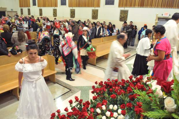 St. Patrick's Catholic Church parishioners approach the altar during Tuesday's Our Lady of Guadalupe celebration.