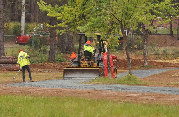 Construction crews work on a path surrounding Lions Lake Wednesday at the Nevada County Fairgrounds.