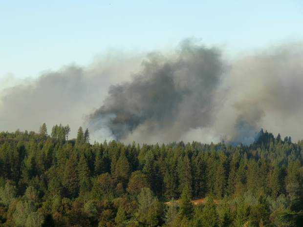 Plumnes of smoke from the Lobo fire Monday morning.