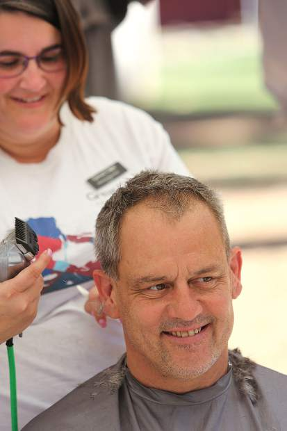 Mike Hayward, a US Army Veteran from 1985-1992, gets his hair cut from Great Clips' Nichole Raymond, who donated her time to cut hair for free during the All Veterans Stand Down.