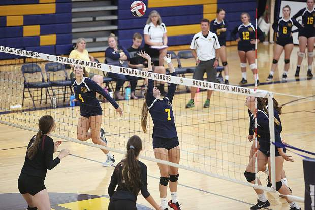 Nevada Union's Bekah McGill (7) sets up the spike for fellow team mate Meadow Aragon (4) during the Miners' pre-season girls volleyball matchup against the Bear River Lady Bruins Thursday at Nevada Union High School.