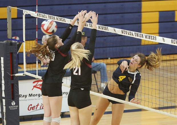 Nevada Union senior Meadow Aragon watches as her spike sails past a pair of Bear River defenders.