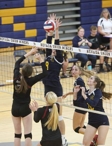 Nevada Union's Teola Nowak (8) comes up with a big block against Bear River.
