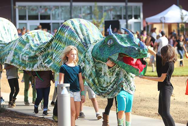Fourth graders from Mrs. Wilkinson's class, carefully escort the dragon back to class following the presentation of Sir George and the Dragon.