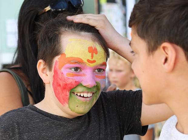 Yuba River Charter School 6th grader Robinson Miller smiles as he shows off his face painting to his friends.