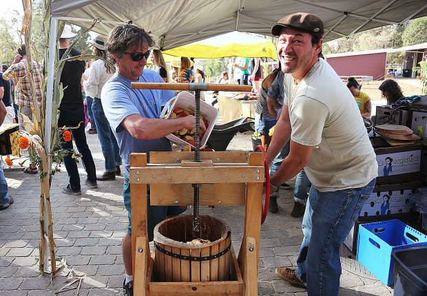 Yuba River Charter School third grade parent volunteers work diligently on the cider press making fresh apple cider during Friday's Harvest Festival. The annual festival was an opportunity to showcase the new Grass Valley campus.