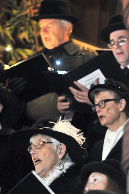 Members of the Cornish Carol Choir sing from from their wide array of classic christmas tunes during Friday night's final Cornish Christmas event of the year in downtown Grass Valley.