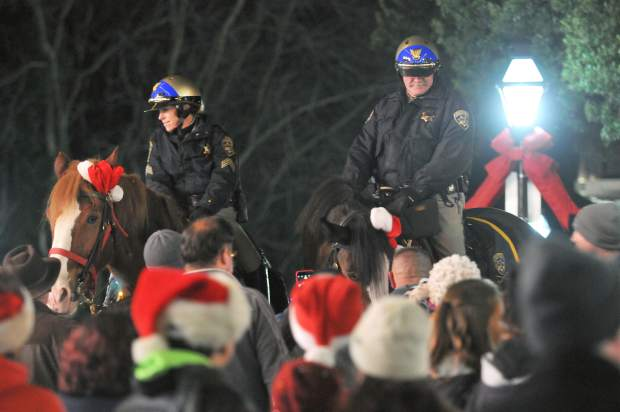 A pair of mounted CHP officers and their horses draw plenty of attention during Friday night's final Cornish Christmas event of the year.