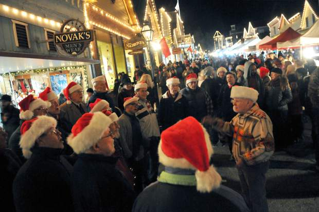 Members of the Sierranaders Barbershop Chorus out of Auburn, serenade street faire goers of Wednesday's Victorian Christmas, the final Victorian Christmas date of the the year.