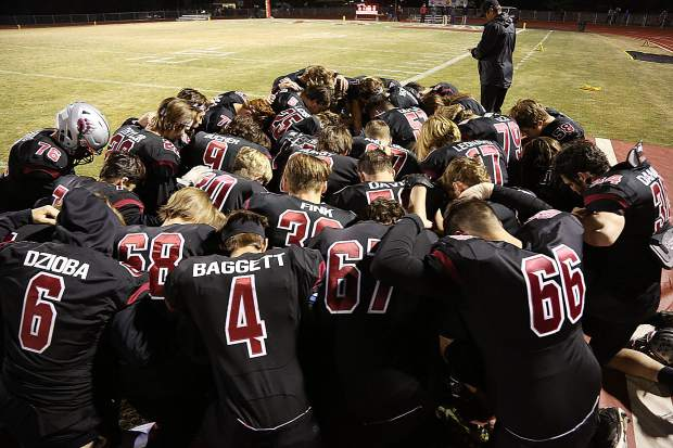 The Bear River varsity football team prays before taking the field against the Center Cougars Friday night.