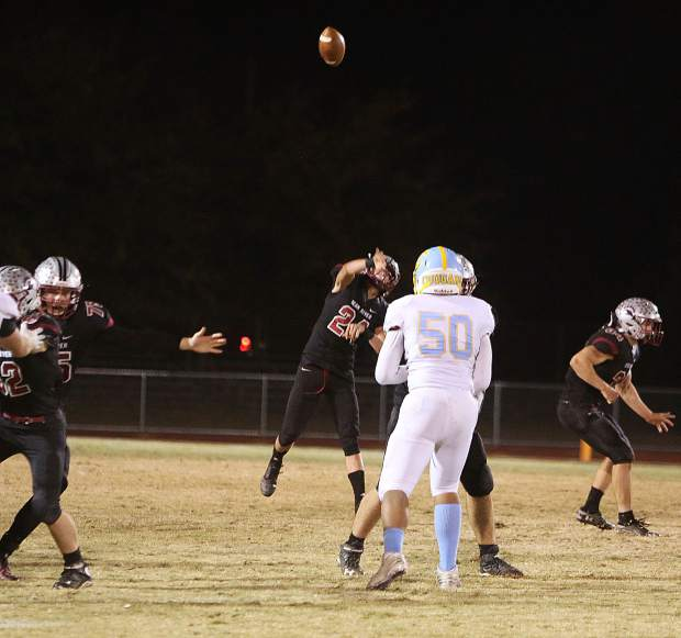 Tre Maronic throws a deep pass to Calder Kunde during second half game play against the Center Cougars.