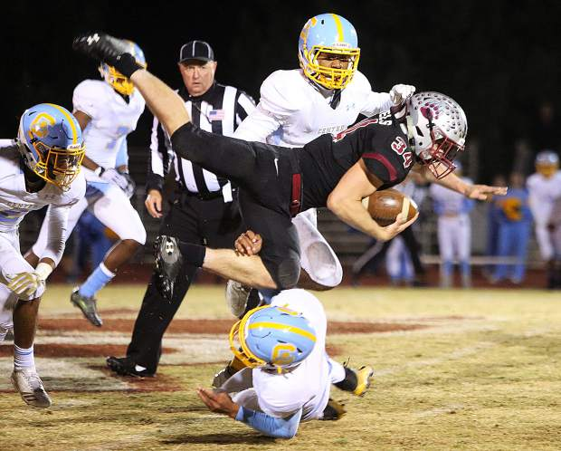 Bear River senior fullback Hunter Daniels (34) rushed for 113 yards and three touchdowns, helping the Bruins to a second round playoff win over Center High School Friday night.