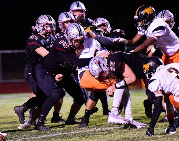 Bear River defenders swarm a Foothill ball carrier.