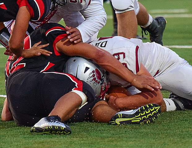 Bear River's Sam Davis falls on a fumble during the Bruins' 49-0 victory over Pershing County (Lovelock, Nevada).